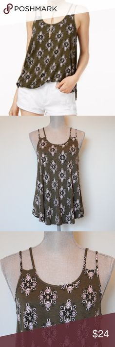 NWT Hippie Rose double strap tank top Beat the heat or enjoy the sun in Hippie Rose's tank top with double spaghetti straps, a rounded hem and a pretty print. #531  -Size small -Scoop neckline; pullover style -Double spaghetti straps -Rounded high-low hem -Easy fit; hits at hip -Rayon/spandex -Hand wash  NO trades. Bundle for additional discounts. I have permission from Macy's to use stock photos. Hippie Rose Tops Tank Tops