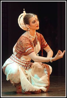 Beautiful! Odissi is a devotional dance form originating in the temples of ancient India. Curvaceous movements, sculptured poses, fluid grace, and impeccable rhythm characterize this vibrant art.