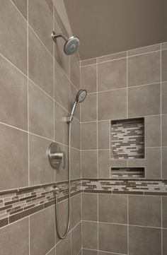 Sammamish Master Bathroom Remodel - Gray is the new neutral...This shower has beautiful neutrals and a splash of bling with the decorative tile liner and built in shampoo niche. Shower fixtures by Hans Grohe