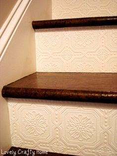 Wallpaper on stair risers, simple way to add texture and character  DIY..reminds me of antique embossed tin ceilings