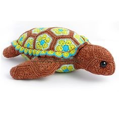 Atuin the African Flower Turtle Crochet Pattern by Heidi Bears - This pattern is available for $6.50 USD. Atuin the turtle is the eleventh of my patterns that makes use of the African Flower hexagon crochet motif and variations thereof, joined in a specific order to make a recognizable 3D item.