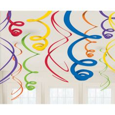 Fill the air with swirling beauty when you hang Rainbow Plastic Swirl Decorations. The decorations feature dangling swirls in assorted colors that add visual excitement to the party room. Each pack includes 12 plastic swirl decorations that hang easily from the ceiling. Rainbow Plastic Swirl Decorations are 22 inches long.