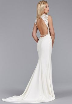 Ivory Silk Crepe modified A-line bridal gown, Alencon lace bodice, drop waist, open back with crystal trim detail chapel train.