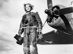 Life magazine photojournalist Margaret Bourke-White wears high-altitude flying gear in front of an Allied Flying Fortress airplane during a World War II assignment in February 1943. (AP Photo)