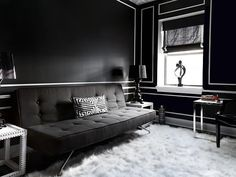 The black-and-white guest room faces east so it gets a little more direct sunlight and it