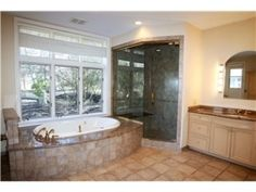 First floor master suite has 2 full baths (one with a gas fireplace and whirlpool tub) and plenty of closet space.