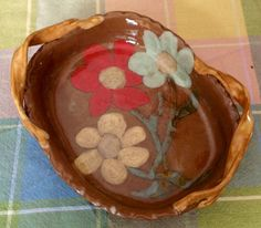 Pottery dish- SOLD 55. Hand painted design