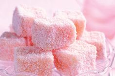 Pink lamingtons (squares of sponge cake dipped in frosting, then coconut). Delicious and pretty for a sweet table.