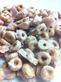 Just lay your Cheerios or fruit down on a parchment paper lined pan and cover them with your yogurt!  I mix them up really good so they are covered on all sides. Then just pop them in the freezer for about 20 minutes so they set up.