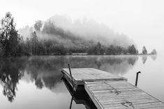 Black and white photograph of a foggy morning by the lake, mountaintops covered in fog. Available as poster and laminated picture at Printler, the marketplace for photo art. Gal, Foggy Morning, Picnic Table, Erika, Sun Lounger, Photo Art, Printer, The Outsiders, Photograph