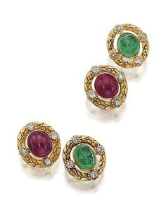 PAIR OF 18 KARAT GOLD, RUBY AND EMERALD CUFFLINKS, FRENCH, CIRCA 1900. The oval links chased with laurel leaves and berries, set with 2 cabochon rubies and 2 cabochon emeralds, each framed by 4 single-cut diamonds, assay marks. With fitted box stamped Janesich, Paris.