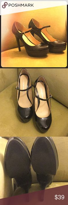 Black patent leather platform pumps This is a classic retro patent leather pump. In gently used condition a few minor scuffs at the back of the shoe hardly noticeable. Great with a pair of jeans, capris, or that wonderful retro 50s style dress! Chinese Laundry Shoes Heels