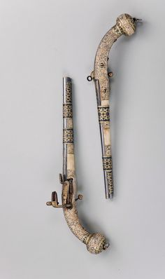 Pistol Place of creation: Daghestan Author (Master) : Masters Muhammad and Abkar Date: 1871-1872 School: village of Kubachi Material: steel, silver and bone Technique: forged, cast, carved, decorated with inlay, nielloed and gilded.