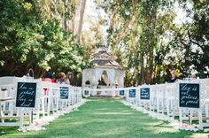Lining the aisle with quotes on what the Bible says about love. - 10 Pretty Ways to Line Your Wedding Aisle | PreOwnedWeddingDresses.com