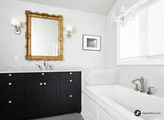 Add drama with a #marble surround and vanity.