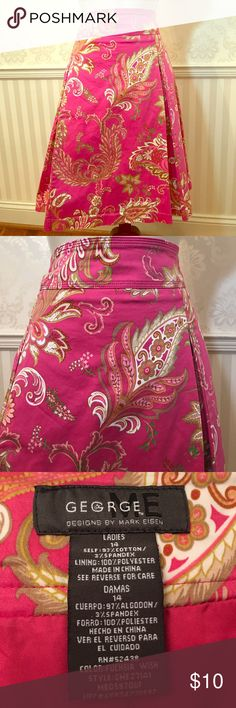 """Bright Pink Paisley Pleated Skirt George designed by Mark Eisen skirt in excellent condition. Bright pink paisley print. Flattering front pleats. So chic and stylish! Fully lined. Waist is approximately 36,"""" length is about 23."""" Skirt is 97% cotton, 3% spandex; lining is 100% polyester. Size 14. George Skirts"""