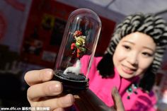 A tourist looks at a sculptured dough figurine in the form of the Monkey King at a temple fair in Beijing.