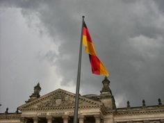 The huge German flag over the Reichstag in Berlin. Magical scene and ambivalent feelings.