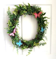 Summer Wreath: How to Make a Romantic Butterfly Wreath. Learn how to use butterfly decorations to welcome in the warm weather and greet your guests. Thanks Etsy Shop Wedding and Wreaths for letting us feature!