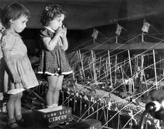 "In September 1950, two girls from the Belle Bryan Day Nursery visited Miller & Rhoads in downtown Richmond to see the Dunn Bros. miniature circus – ""the biggest little show on Earth,"" as it proclaimed itself. The 475,000-piece circus took five men 48 hours to set up on a 60-by-28 foot-table – and seven hours to break down."