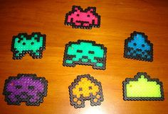 Suddenly I find myself hooked on Perler Beads. How'd this happen? I've been making nerdy video game sprites to hang on my Christmas tree. :) We have an enormous tree, I needed more decorations!