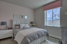 Lower level girls' bedroom, pretty pink accent wall. #Fresco