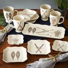 Winter Sports Dinnerware - Enjoy a feeling of warm nostalgia with these cozy Winter Sports plates, mugs and tray. Featuring four different renderings of vintage winter sports gear that includes skis, ski poles, snowshoes and a sled, this collection is perfect for serving appetizers and sipping coffee or cocoa on your next weekend ski trip.