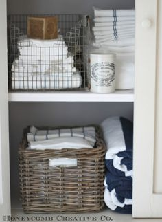 LINEN CLOSET SHELVES :: Honeycomb Creative Co.: The Linen Closet {Small Space Storage}. I have the wicker basket, but would love to own the wire basket! I love how it's folded inward--looks nice & smooths out rough edges.