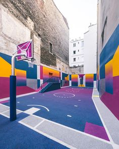 A basketball court hidden between apartments in Paris explodes with color for an avant-garde design…""