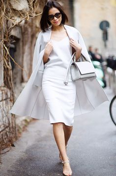 Try a sleek slip dress in an icy shade off-white this summer. #streetstyle