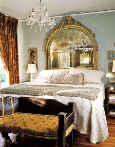 I love everything about this bedroom!  The Mirror, the chandelier,the silver spread ... the Victorian feel!