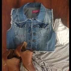 Denim Vest Distressed denim vest. 2 pockets in front,button down.Versatile wear it with a dress with shorts or pants. Tops