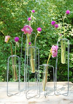 14.99 SALE PRICE! Fill this quirky Test Tube Centerpiece with colorful blooms to enhance your table! Use fresh flowers or silk flowers for a natural look, or...
