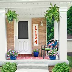 Craftsman-style pillars and punchy accessories help a tired front entry put on a welcoming face