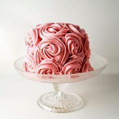 I personally love these small individual cakes for two. They seem much more special and intimate, maybe it's just me. They seem to hold up to the more elaborate decorating to. This one is soo pretty almost to pretty to eat...almost
