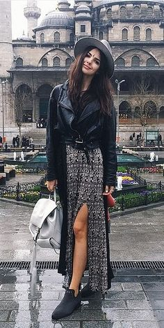 A Leather Jacket, Black Top, Patterned Skirt, Booties, and a Hat