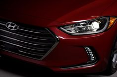 2017 Elantra Sedan - modern lighting signatures, including available HID headlights with Dynamic Bending Lights and unique vertical LED daytime running lights