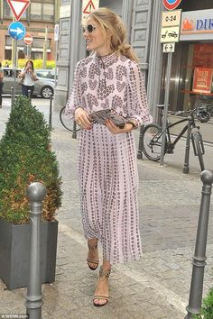 Olivia Palermo wearing Meli Melo on the Go Snakeskin Splatter Clutch and Gianvito Rossi Augusta Sandals