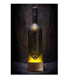 Wine bottle lamp with wooden base and Latvian folk by SMITALAMPAS