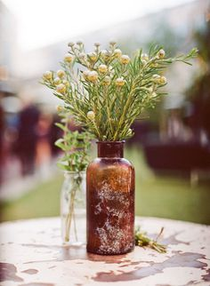 I love the old bottle. This arrangement would look good on my kitchen windowsill. I love the simplicity.