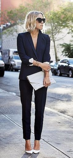 A Black Suit Set, White Heels, and a White Clutch