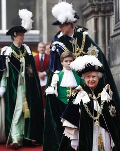 The Queen smiles as she leaves St Giles Cathedral, followed by the Princess Royal and the Duke of Cambridge