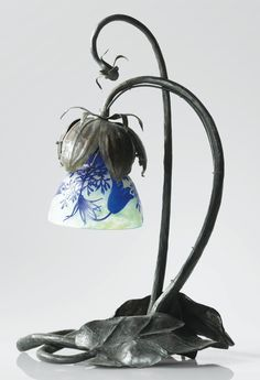 Daum LAMPE DE TABLE, VERS 1910 A CAMEO GLASS AND PATINATED IRON TABLE LAMP BY DAUM, CIRCA 1910. SIGNED