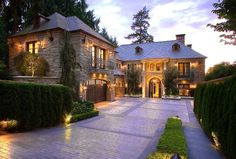 This gorgeous Mediterranean inspired waterfront estate is located at 3645 Hunts Point Road in Hunts Point, WA. The beautiful stone mansion, which sits at the end of a long private driveway, was built in 2003 Stone Mansion, House And Home Magazine, House Goals, Luxury Real Estate, My Dream Home, Dream Life, Dream Homes, Exterior Design, Future House