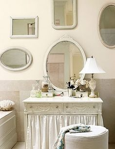 mirrors used to decorate walls (I like the curtain on the table)