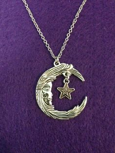 Ornate Silver Crescent Moon and Star Charms on a by CraftyOlBats