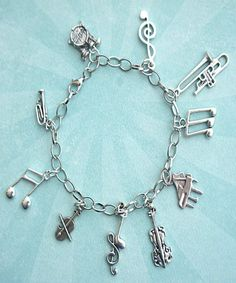 Bracelet Handmade Silver Tone Treble Clef Charms Secured with a Lobster Clasp