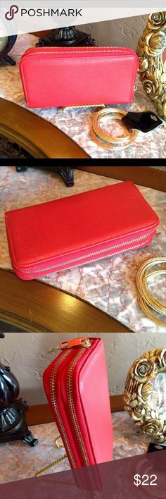 Red Double Compartment Wallet This faux leather wallet features to gold tone zip compartments. One side has credit card slip pockets and the other side has slip pockets and one zipper pocket. Includes a wrist strap. (This closet does not trade or use PayPal) Son Paises Bags Wallets