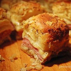 Hawaiian bread ham & Swiss sandwiches 2 pkg Hawaiian rolls 1 ½ lbs smoked ham 12 slices Swiss cheese 1 stick butter 2 tsp Worcestershire sauce 1 tsp Garlic Powder 1 tsp Onion Powder 1 tsp poppy seeds Place bottoms of rolls pan. Layer 2 shaved slices. Quarter cheese & place 2 small slices on each. Add roll tops. Melt butter & whisk in sauce & seasonings. Brush over sandwiches. Cover & refrigerate 1 hour or overnight. Bake 375° 15 minutes or until cheese melts.