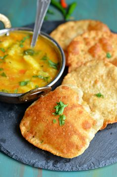 Lentils and wholewheat flour Indian puffed bread- These mildly spicy Pooris are served with potato curries for breakfast on festivals. Best Indian Recipes, Asian Recipes, Ethnic Recipes, Raw Food Recipes, Healthy Recipes, Vegetarian Recipes, Puri Recipes, Potato Curry, Indian Dishes